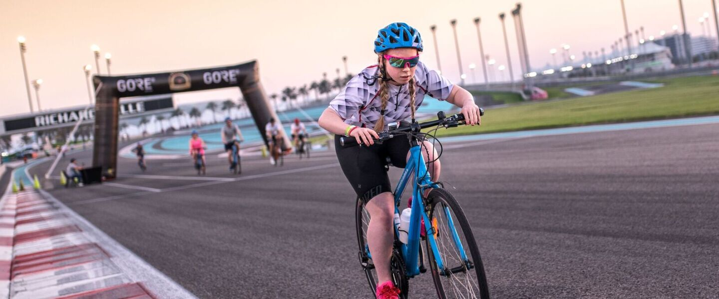 Getting Started Lede - A Focused Female Athlete Rides a Bicycle on the Racetrack at the IX MENA Games in Abu Dhabi, 2018
