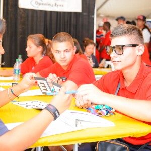 Two Young Serbian Athletes Sit for a Healthy Athletes Opening Eyes Exam at the 2015 Summer World Games, Los Angeles