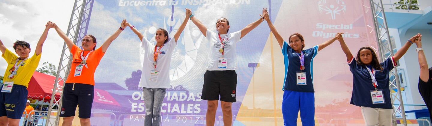 Grants Lead - Female Champions Celebrating Atop the Podium at the 2017 Special Olympics Latin American Regional Games in Panama City