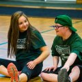 Two Students at Dover HS in New Hampshire Sit on the Gym Floor During Physical Education Class, Part of Their Inclusive P.E. Wellness Program