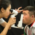 Opening Eyes - Mexican Swimmer Christian Gonzalez Gets an Eye Exam During a Healthy Athletes Event in Southern California, 2014