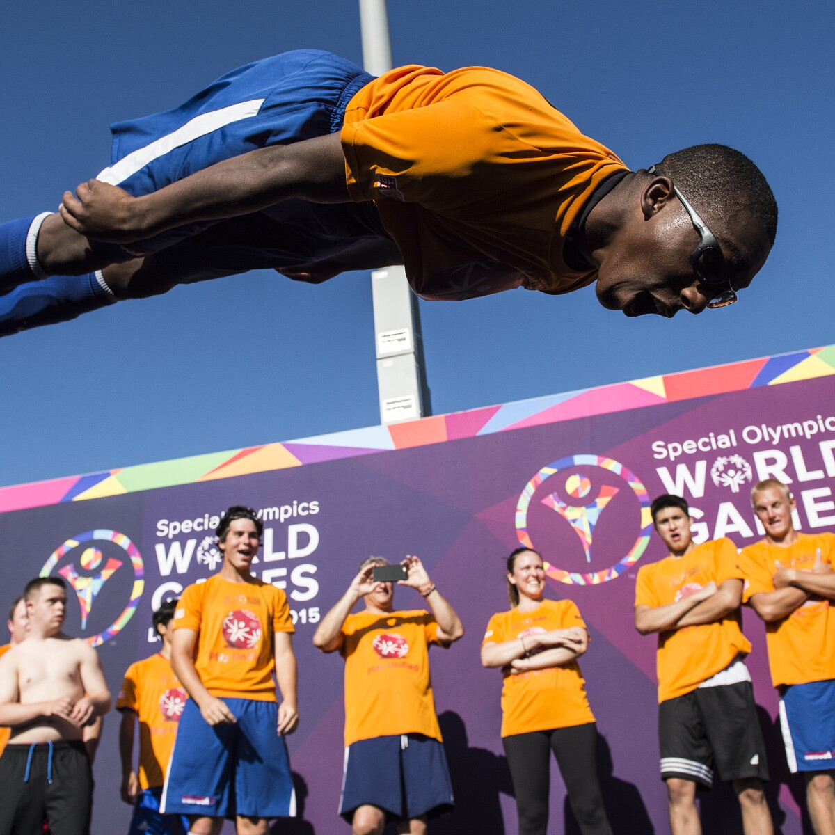 Soccer Players Jumping During the Unified Sports Experience at Special Olympics World Games, Los Angeles, 2015