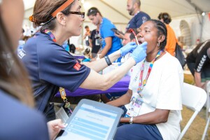 A Female Athlete from Seychelles Gets a Special Smiles Dental Exam During a Healthy Athletes Event at the 2015 World Summer Games in Los Angeles