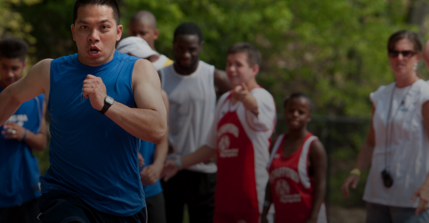 Homepage Lede Image - Khang Le of Special Olympics Virginia Runs on a Track During an Event