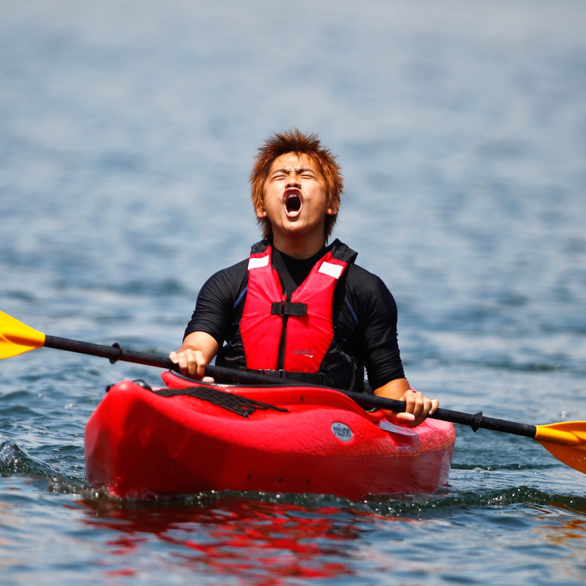 Taiwanese Kayaker Kuan-Hao Chiu Yells with Excitement During Competition at the 2011 World Summer Games in Athens, Greece