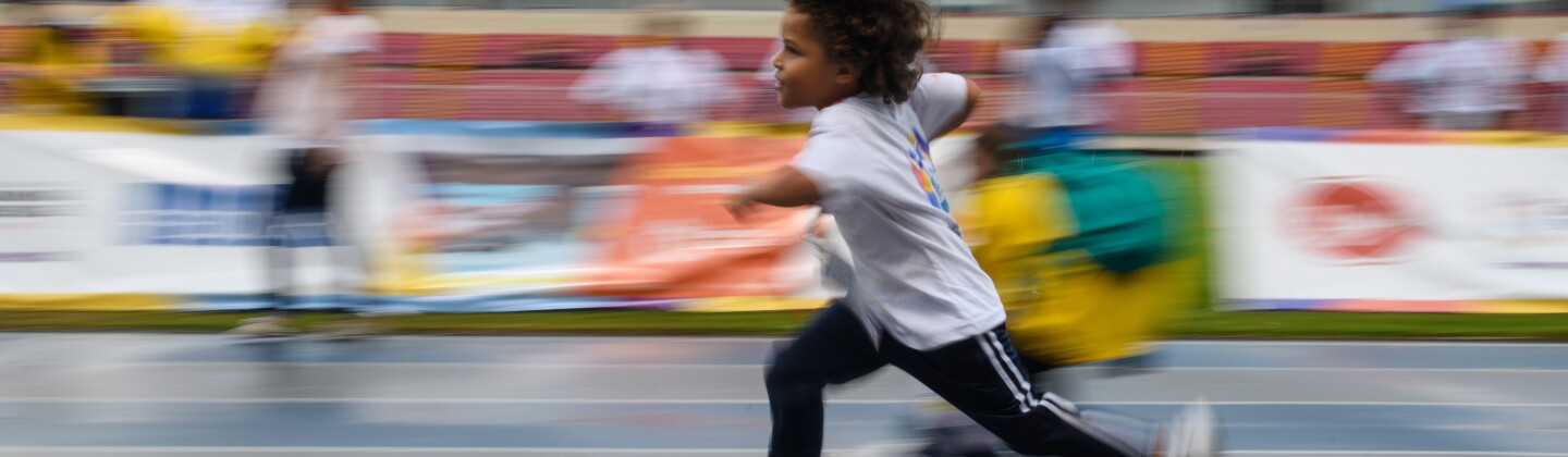 Fitness Wellness Professionals Lede - Child Running on Track at Latin America Regional Games, Panama City, April 2017