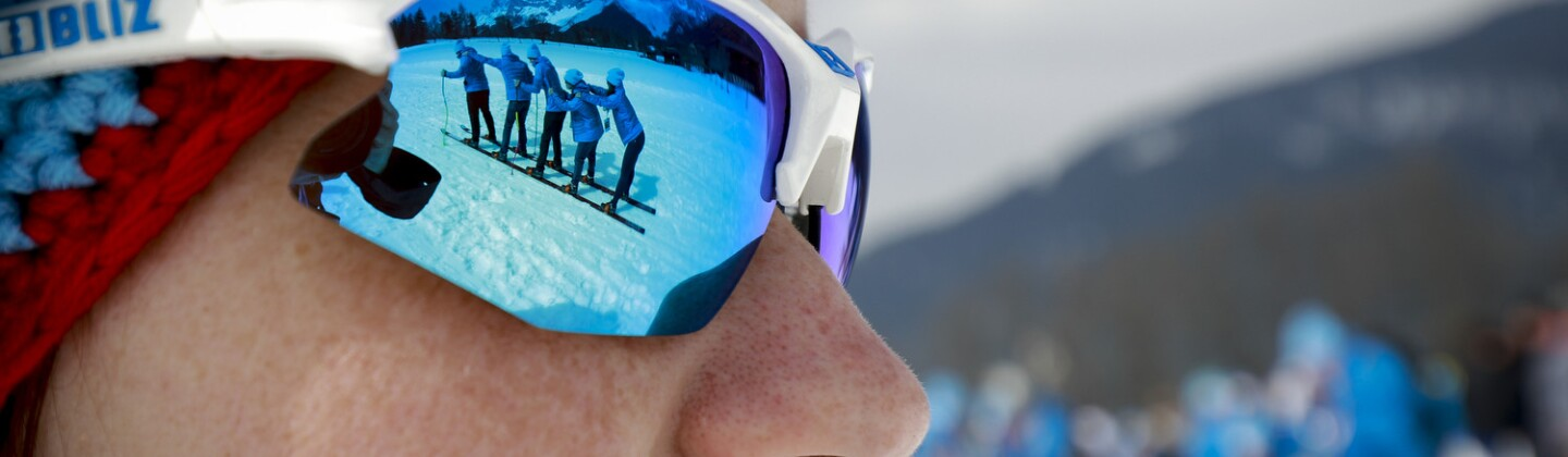 Resource Center Lede - A Norway Athlete Looks On as Teammates Cross Country Ski on the Mountain in Schladming, Austria During the 2017 World Winter Games