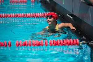 Smiling Young Female Mexican Swimmer, Michelle Falcon, in the Pool at the 2014 Special Olympics Southern California Invitational Games