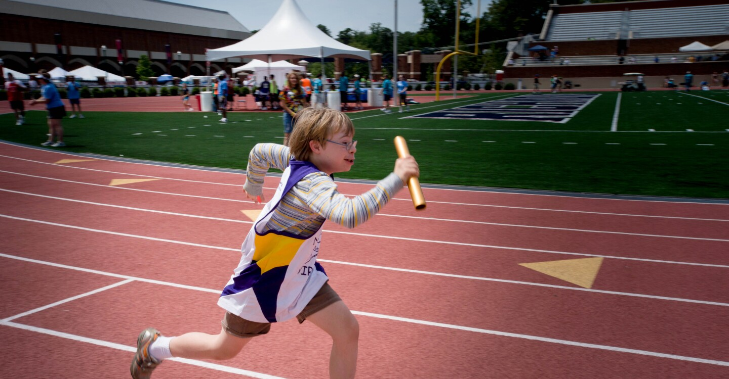 Tools Lede - Young Special Olympics Athlete Runs in a Relay Race in Virginia