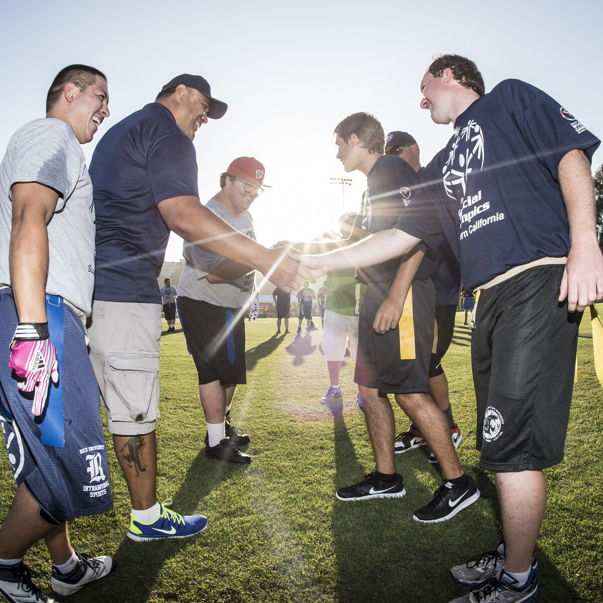 Flag Football Competitors Shake Hands on the Field During a Unified Sports Experience Event at the 2015 World Summer Games in Los Angeles, California