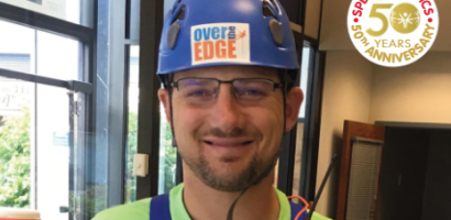 Special Olympics Health Messenger Parker Thornton in Climbing Gear with Over the Edge
