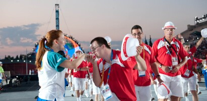 A Delegate of Special Olympics Team Österreich (Austria) Kisses the Hand of a Staff Member During the Opening Ceremony Procession of the 2011 World Summer Games in Athens, Greece