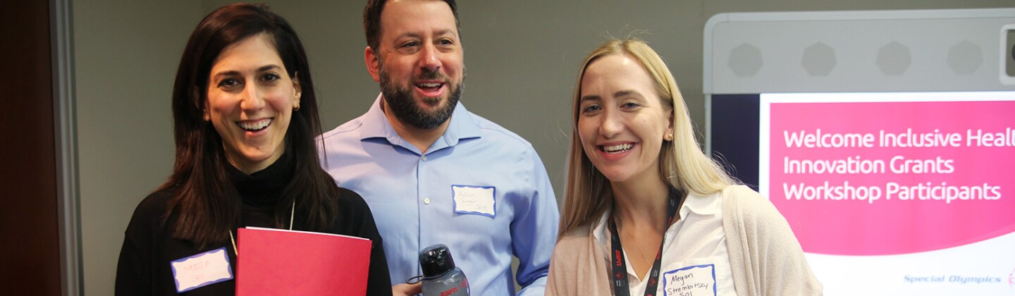 Nadja, Adam, and Megan Smile at the Beginning of the 2019 Inclusive Health Grantees Workshop at Special Olympics Headquarters