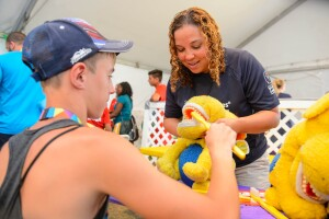 A Boy Practices Brushing Teeth on a Stuffed Animal at a Special Smiles Healthy Athletes Event at the 2015 World Summer Games in Los Angeles