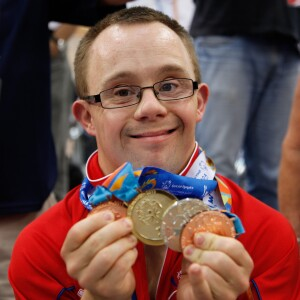 Powerlifting Athlete Nathan Fisher, of Great Britain, Celebrating Four Medals Won at the 2011 Special Olympics World Summer Games in Athens