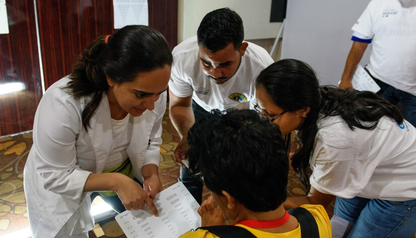 A Public Health Professional Conducts an Opening Eyes Vision Test During a Healthy Athletes Event at the Latin American Regional Games in Panama City, 2017
