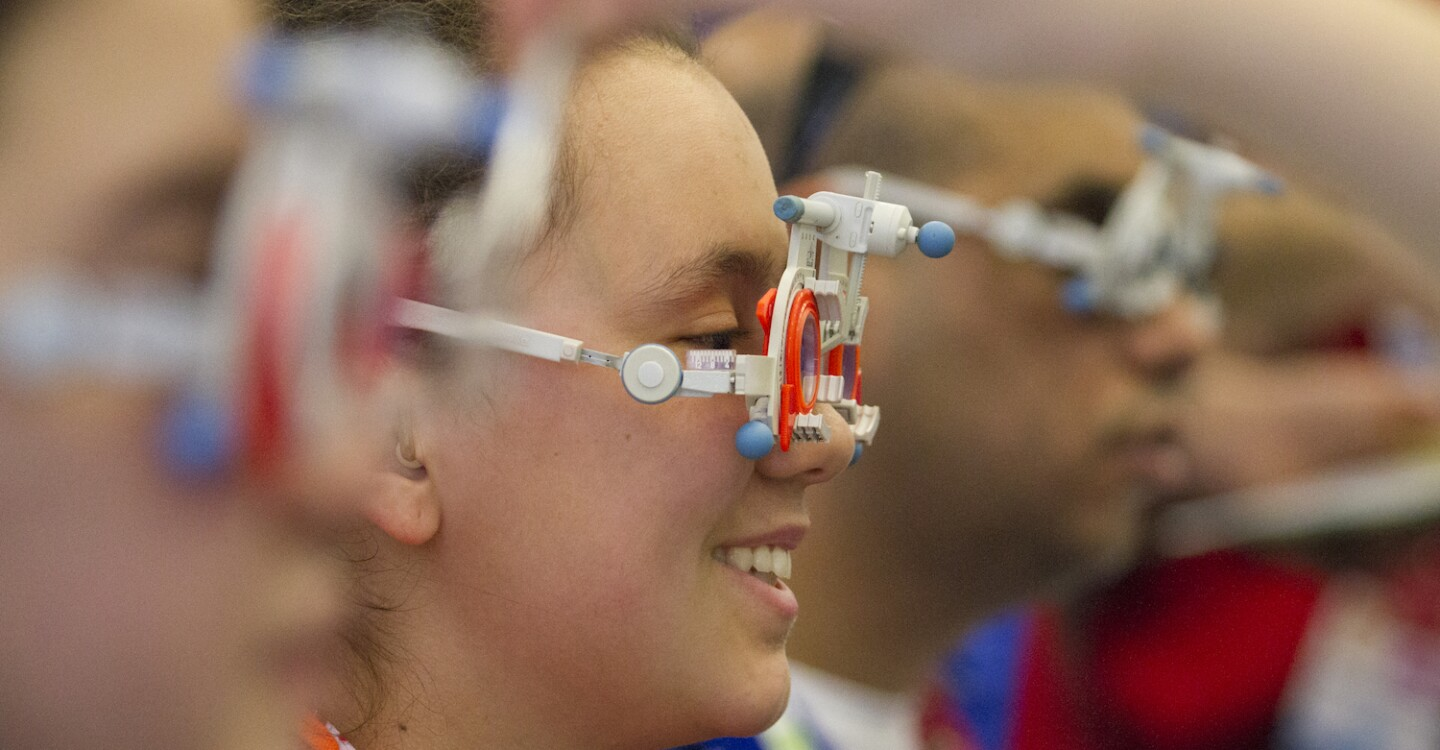 Emerging Solutions Lede - Woman Smiles During a Healthy Athletes Opening Eyes Vision Test, Austria, 2017