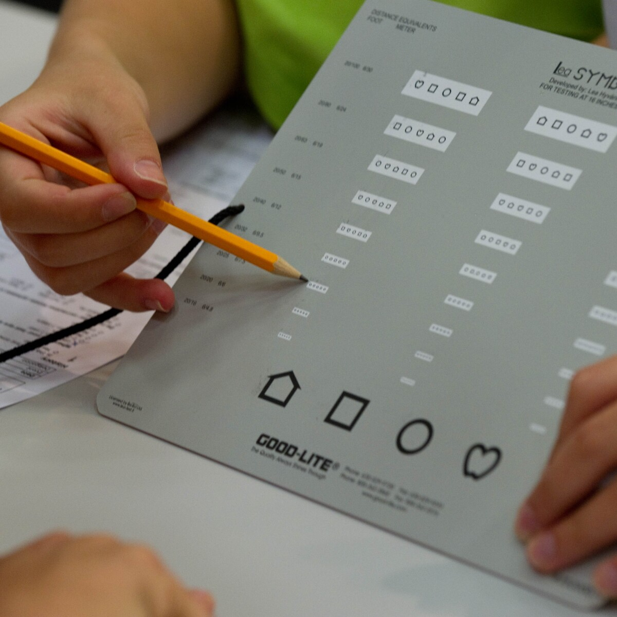 A Volunteer Uses a Vision Test Board During a Healthy Athletes Opening Eyes Screening at the 2011 World Summer Games in Athens, Greece